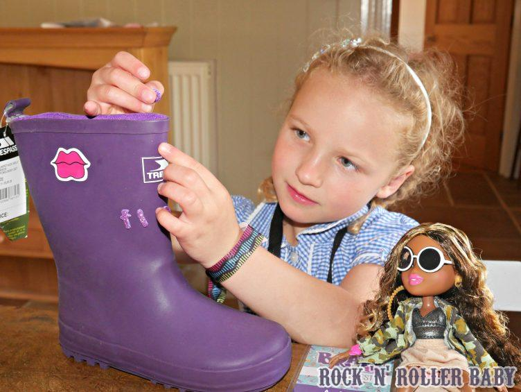 Decorating her boots and playing with Sasha, one of the new Bratz Festoval Vibes dolls!